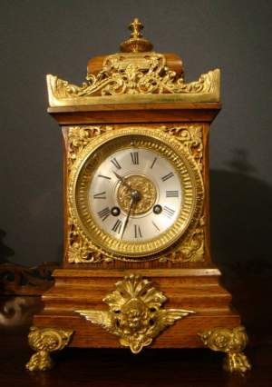 French Oak and Bronze Mounted Clock