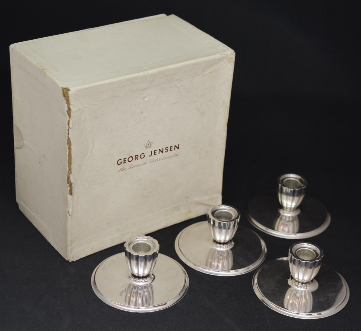 set of four georg jensen silver candlesticks metalware. Black Bedroom Furniture Sets. Home Design Ideas