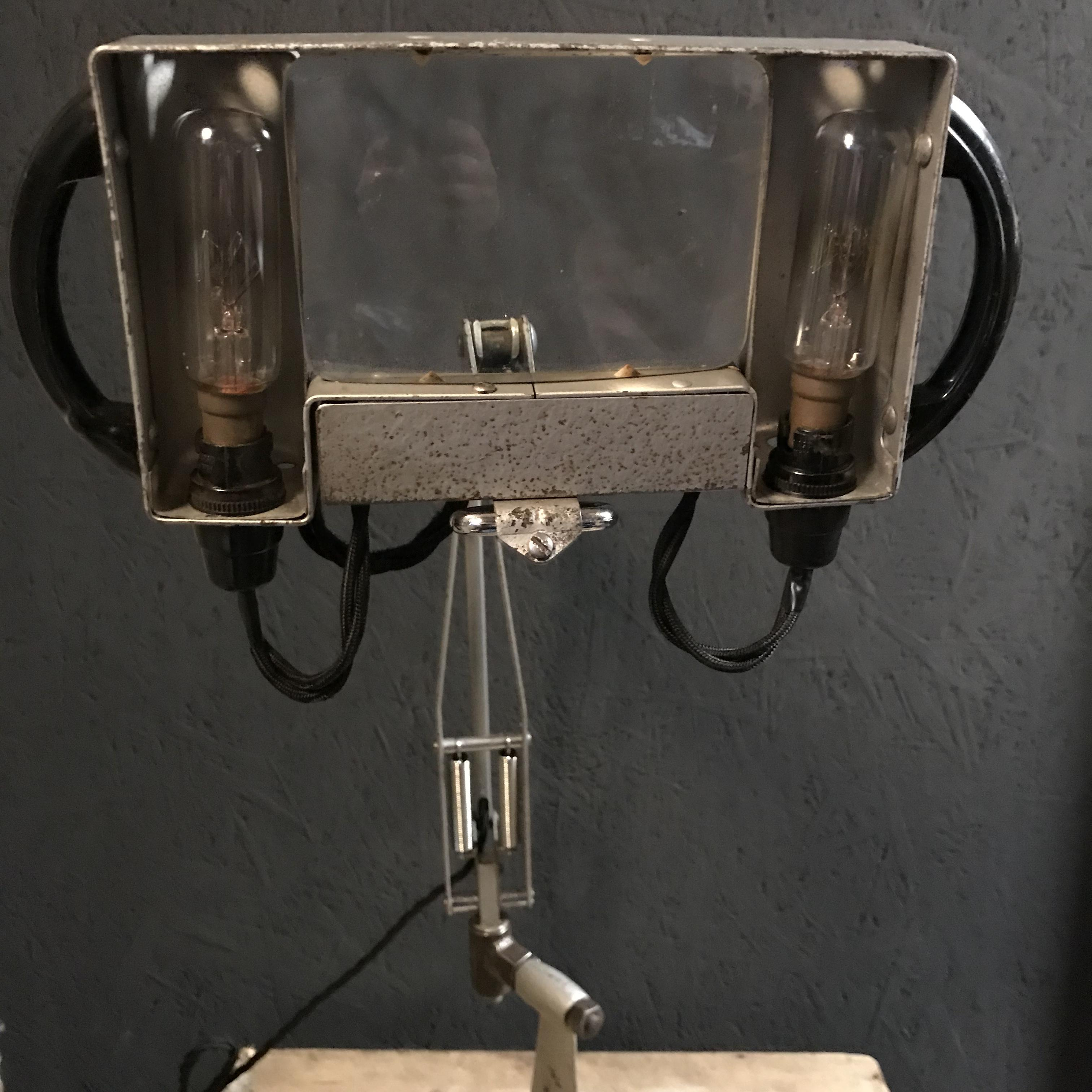adjustable floor with light anglepoise spring type lamp