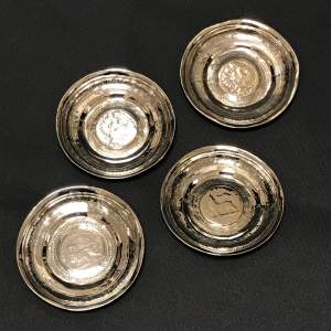 Four Silver Dishes with Inset Coins