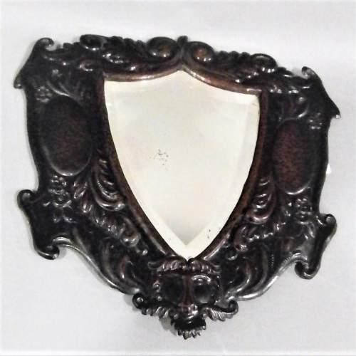 A Unique Arts and Crafts Decorative Shield Shaped Mirror Circa 1910 image-1