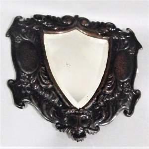 A Unique Arts and Crafts Decorative Shield Shaped Mirror Circa 1910