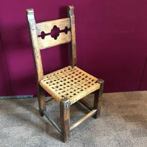 Naive 17th Century Walnut Chair with Village Stocks Back