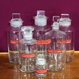 Set of Six Glass Apothecary Jars With Various Labels