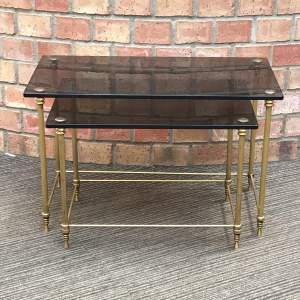 Hollywood Regency Nest of Two Glass Topped Brass Tables