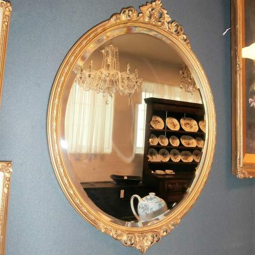 Oval Bevelled Wall Mirror in Decorative Gilt Wooden Frame image-1