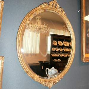 Oval Bevelled Wall Mirror in Decorative Gilt Wooden Frame
