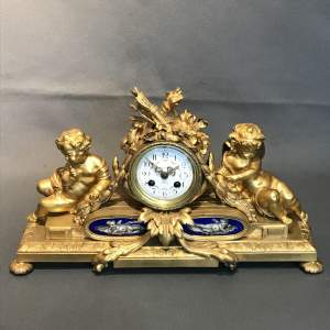Late 19th Century Ormolu French Clock with Porcelain Panels