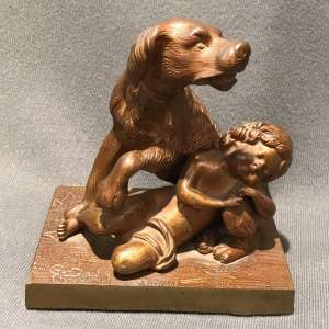 Bronze Figure of a Dog and a Child