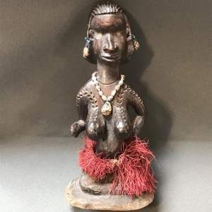 An African Carved Wooden Fertility Figure