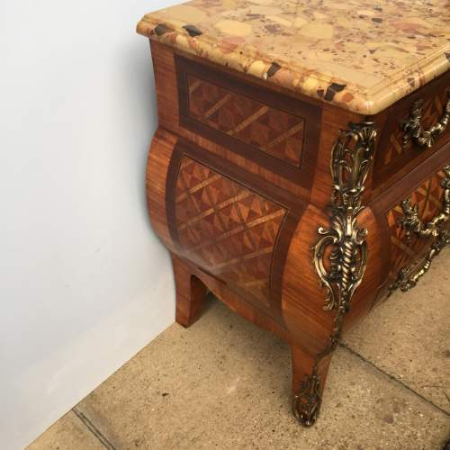 A French 19th Century Brass Mounted Kingwood And Parquetry Bombe Commode image-3
