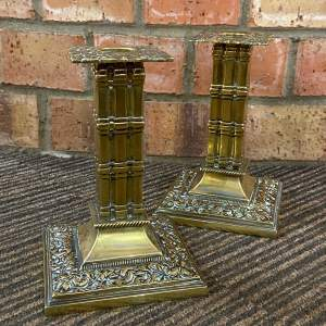 Pair of Arts and Crafts Brass Cluster Column Candlesticks