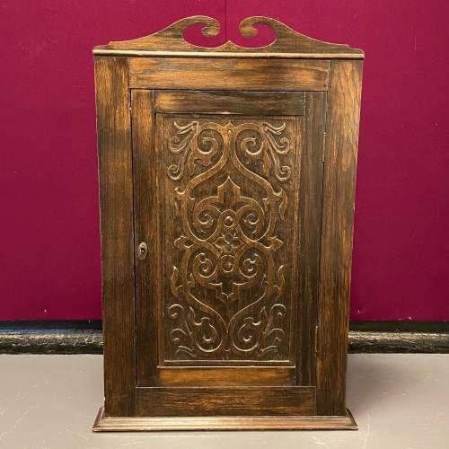 Early 20th Century Carved Oak Corner Cupboard image-1