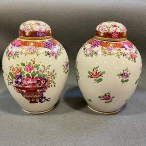 Pair of Florally Decorated Lidded Tea Pots