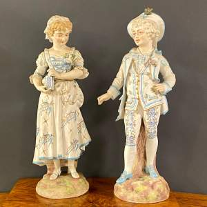 Large Pair of Victorian Bisque Figures of Young Boy and Girl