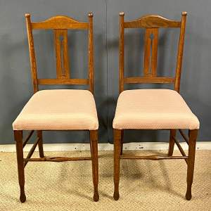Pair of Arts and Crafts Oak Framed Chairs