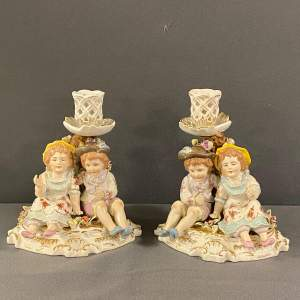 Pair of Porcelain Figural Candlesticks