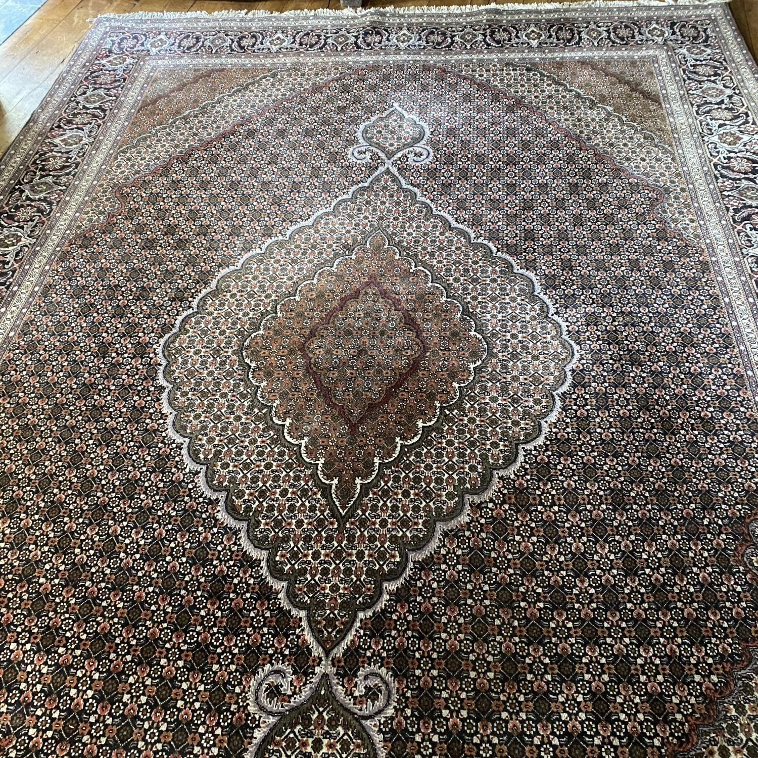 A Stunning Hand Knotted Persian Rug