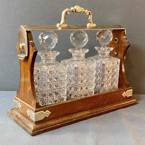 Antique Oak and Silver Plate Three Bottle Tantalus image-1