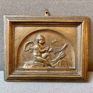 Late 19th Century Bronze Plaque Depicting an Amorini