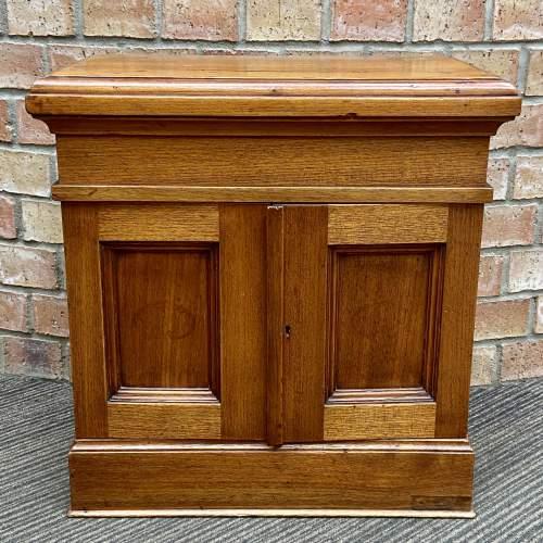 Small Oak Two Door Storage Cabinet image-1