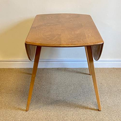 Ercol Five Piece Dining Table and Chairs image-3