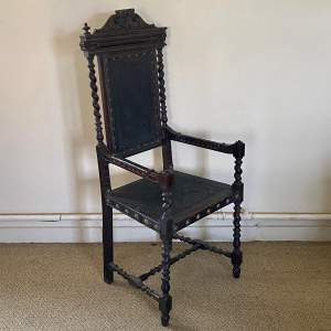 Carved Mahogany and Leather Elbow Chair
