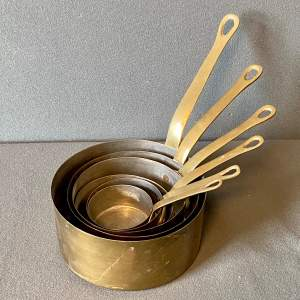 Set of Six Graduated Brass Saucepans