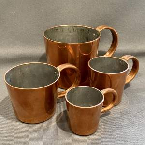 Late Victorian Set of Four English Copper Rum Measures