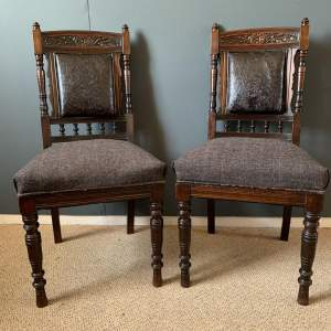 Pair of Tooled Leather Back Chairs