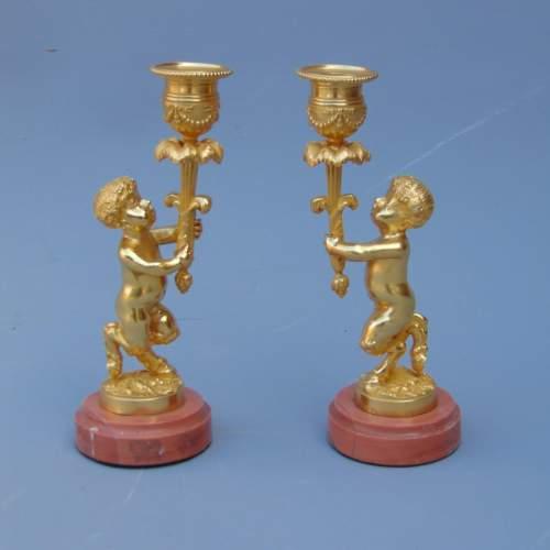 A Pair of Ormolu Cherub Candlesticks image-1