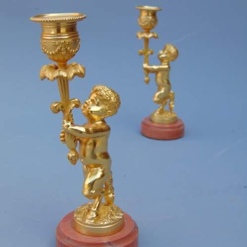 A Pair of Ormolu Cherub Candlesticks image-4