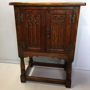 Small Two Door Oak Cupboard With Gothic Style Carving