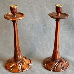 Pair of Arts and Crafts Hand Carved Walnut Candlesticks