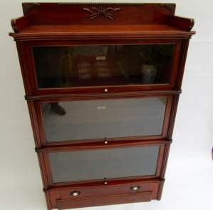 A Victorian Walnut Globe Wernicke Bookcase