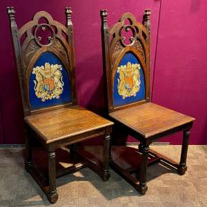 Pair of 19th Century Gothic Revival Coat of Arms Oak Hall Chairs