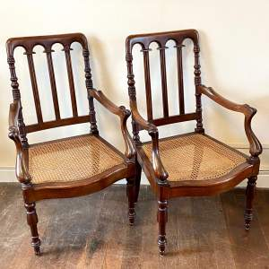 Pair of Late 19th Century Colonial Mahogany Framed Armchairs
