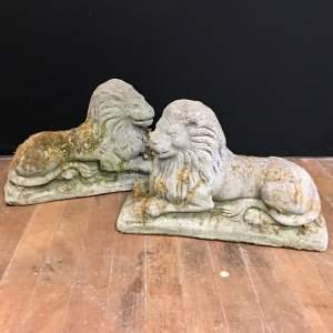 Pair of Cast Stone Recumbent Lion Statues