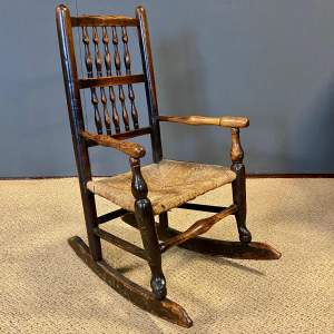 19th Century Childs Ash and Elm Spindleback Rocking Chair