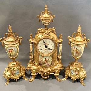A Gilt Metal Sèrves Style Clock Garniture