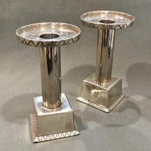 Pair of Arts and Crafts Hugh Wallis Pewter Push Candlesticks