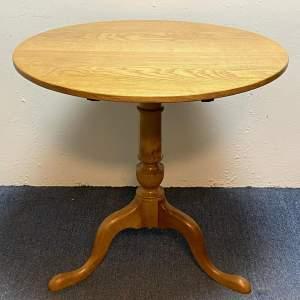 Vintage Light Oak Tilt Top Table