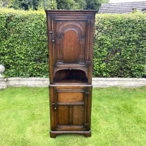 Carved and Distressed Oak Corner Cabinet