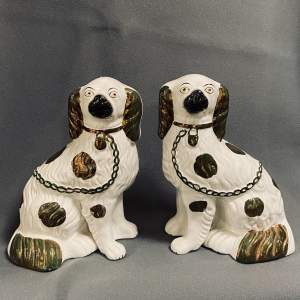 Pair of 19th Century Staffordshire Pottery Copper Lustre Dogs