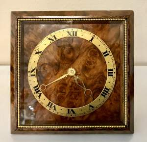 8 Day Timepiece With a Burr Walnut Face and Gilded Strut Back