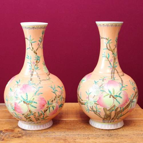Pair of Large Chinese Peach Ground Bottle Vases image-1