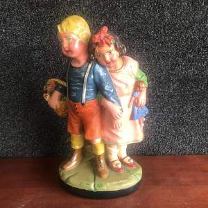 A Vintage Continental Figurine of  a Boy and Girl