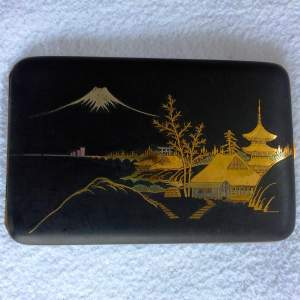 A Japanese Taisho Period Gilded Mixed Metal Case