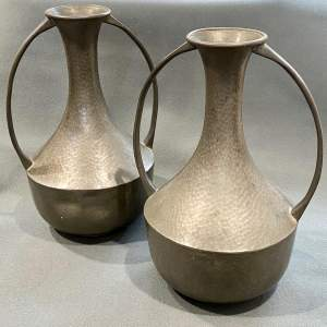 Pair of Arts and Crafts Hand Beaten Pewter Vases