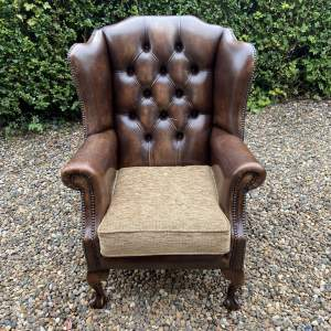 A Brown Leather Chesterfield Wingback Armchair